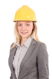 Travailleur de la construction de femme avec le casque antichoc d'isolement Photo stock