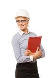 Travailleur de la construction de sourire de femme avec le casque antichoc dessus Photo stock