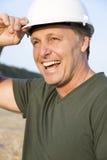 Travailleur de la construction de sourire heureux. Photographie stock libre de droits