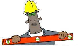 Travailleur de la construction employant un niveau Photos libres de droits