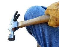 Travailleur de la construction enfilé de gants avec le marteau Photo stock