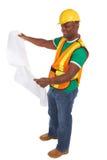 Travailleur de la construction heureux d'afro-américain tenant des modèles Images stock