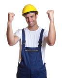Travailleur de la construction latin encourageant photographie stock libre de droits