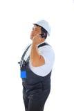 Travailleur de la construction parlant au téléphone Images stock