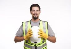 Travailleur de la construction posant avec un masque images stock