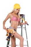 Travailleur de la construction sexy sur l'échelle Photographie stock
