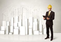 Travailleur de la construction surfaçant avec les bâtiments 3d à l'arrière-plan Image libre de droits