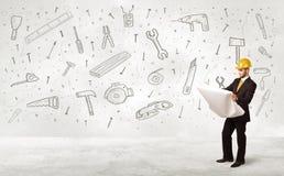 Travailleur de la construction surfaçant avec les icônes tirées par la main d'outil Image libre de droits