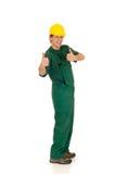 Travailleur de la construction, vert Photos libres de droits