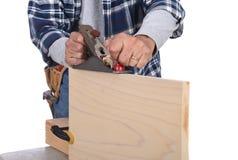 Travailleur du bois avec l'avion Photographie stock