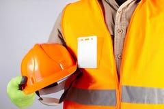 Travailleur en plan rapproché orange de casque de participation d'équipement de veste photos libres de droits