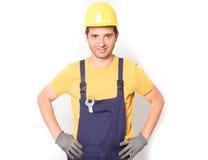 Travailleur habillé dans des combinaisons d'isolement sur le blanc Images libres de droits