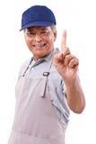 Travailleur heureux de sourire avec le tablier et le chapeau Image stock