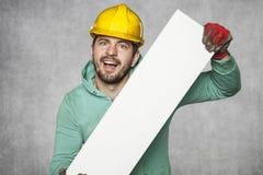 Travailleur heureux fou avec l'espace publicitaire vide Images libres de droits