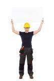 Travailleur manuel tenant l'abover de bannière sa tête Photo libre de droits