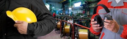 Travailleurs avec l'uniforme de sécurité photo stock