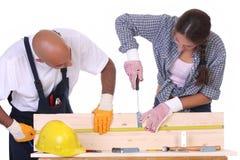 Travailleurs de la construction au travail Photographie stock libre de droits
