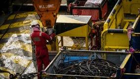Travailleurs en mer photographie stock libre de droits