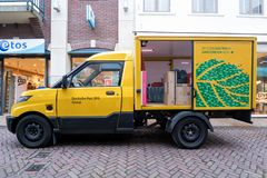 Travaux de StreetScooter de Deutsche Post DHL image stock