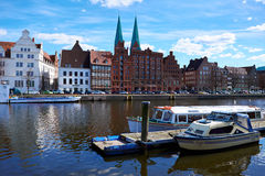 Trave river, old town of Lubek. Germany. LUBECK, GERMANY - APRIL 5, 2015: Old part of Lubeck, is the second largest city in Schleswig-Holstein, northern Germany Stock Photos