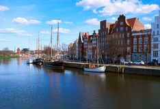 Trave river, old town of Lubek. Germany. LUBECK, GERMANY - APRIL 5, 2015: Old part of Lubeck, is the second largest city in Schleswig-Holstein, northern Germany Stock Images