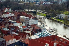Trave river, old town of Lubek. Germany. LUBECK, GERMANY - APRIL 5, 2015: Old part of Lubeck, is the second largest city in Schleswig-Holstein, northern Germany Stock Photo