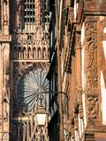 Lantern and west facade of Strasbourg Cathedral. Trave to France - urban lantern on street Rue Merciere and west facade of Strasbourg Cathedral in summer evening Stock Photo