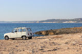 Travel 03. The photo shows an old French car the renault 4 red famous for his adventurous journeys in nature Royalty Free Stock Photo