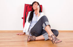 Travel. Woman waiting with baggage phoning Royalty Free Stock Image