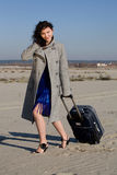 Travel. The woman in grey coat traveling with suitcase Stock Image