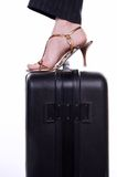 Travel. Woman foot on suitcase in elegant shues Stock Image
