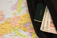Travel. Wallet with British pounds and a passport on a map of Europe Stock Image