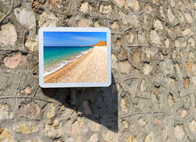 Travel. Scene of the sea beach in frame on wall Stock Photos