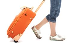 For travel. Photo of elegant female carrying red suitcase Royalty Free Stock Photos