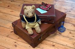 Travel in the 1940s. Suitcases, a Teddy Bear and travel accessories from the 1940s stock photo