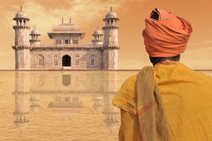 Travel. Poor man near a luxury palace in India Stock Image