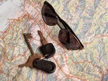 Travel. Map with Glasses and Keys Stock Photography