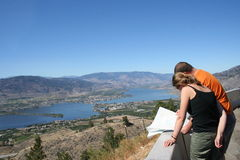 Travel. Couple overlooking a lake on a hill Royalty Free Stock Images