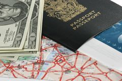 Travel. Passport, map, US money, and ticket - ready to travel Royalty Free Stock Image