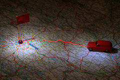 Travel. Photo of a Map with Toy Car and flag Stock Image