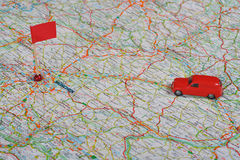 Travel. Photo of a Map with Toy Car and flag Stock Images
