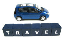 Travel. A miniature car standing behind the word travel stock image