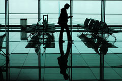 Travel. Woman waiting for the fly, airport Munich, Germany Stock Photos