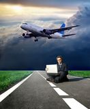 Travel. A business man on the street and a airplane Stock Photography
