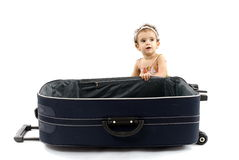 Travel. Baby Girl in the empty Luggage Royalty Free Stock Photo