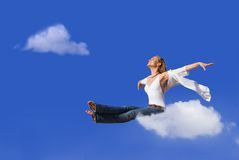Travel. Concept, woman flying or traveling on cloud Stock Image