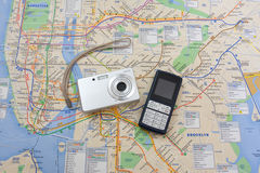 Travel. With NY`s map, digital photo camera and cell phone royalty free stock images