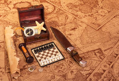 Travel accessories on  background of old maps. Royalty Free Stock Image