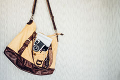 Travel accessories. camera, pen, notebook and torch in bag ready Royalty Free Stock Images
