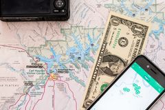 Travel accessories, camera, smart phone, one Dollar bill and travel map, detail of Arizona, USA map. Travel accessories, camera, smart phone one Dollar bill and stock photos
